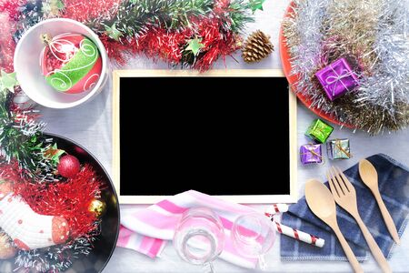 Overhead view of Blank blackboard on Christmas table setting, Rustic decorations, Copy space