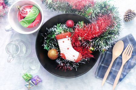 Overhead view of Christmas table setting, Rustic decorations
