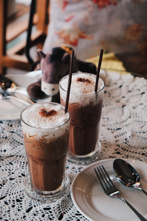 Glass of Cold Iced Mocha Coffee in the Coffee shop, Vintage tone Stock Photo