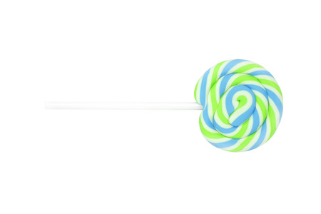 Colorful lollipops, Green lemon lime candy on over white background.