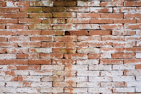 Background of old vintage brick wall with peeling white, texture.