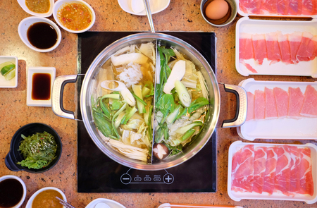 Top view of Shabu shabu boiled pot with meat and all ingredient in resturant.