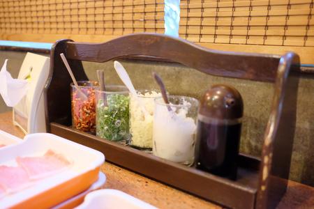 Close up of Seasoning set in Shabu shabu and Suki yaki resturant. Banque d'images - 123549471