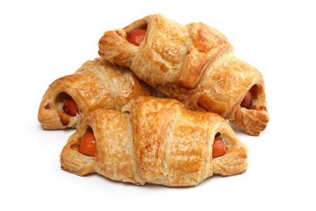 Delicious of sausage croissant on white