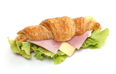 Ham and cheese croissant sandwich on white Banque d'images