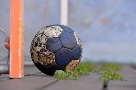 Handball ball on an old floor