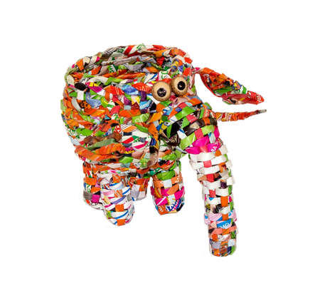 toy elephant: A toy elephant made of candy wrappers on a white background Stock Photo