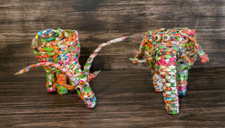 wrappers: Figures of animals from the wrappers on a wooden background Stock Photo