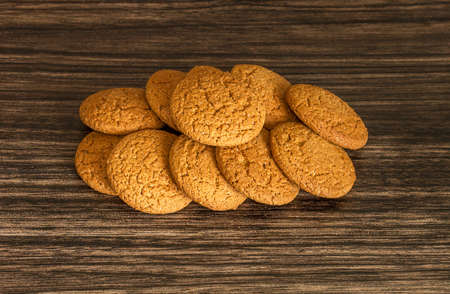 Oatmeal cookies on a wooden background .