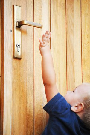 try: little boy try to reach doorhandle