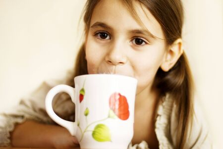 a little girl with a milk mustache Stock Photo - 6286769