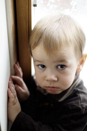 little boy near the window photo