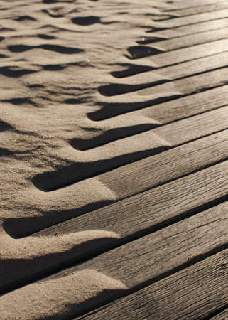 Drifting beach sand blowing up on to boardwalk Stock Photo