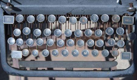 Old vintage style typewriter keyboard Фото со стока
