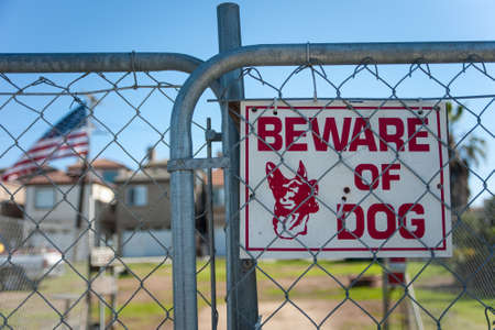 guard house: Guard dog sign on a gate Stock Photo