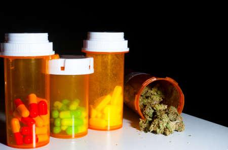 medicinal marijuana: Medical marijuana and pills on a table