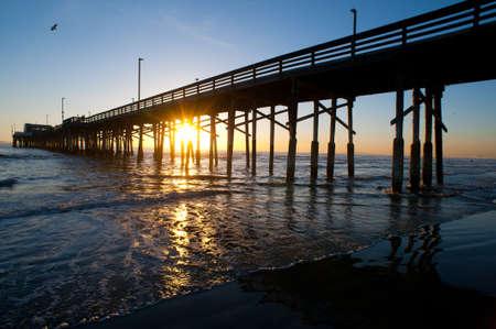 Newport beach pier at the beach sundown photo