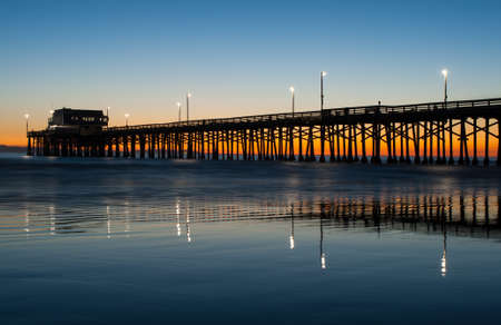 Newport beach pier in orange county at sunset photo