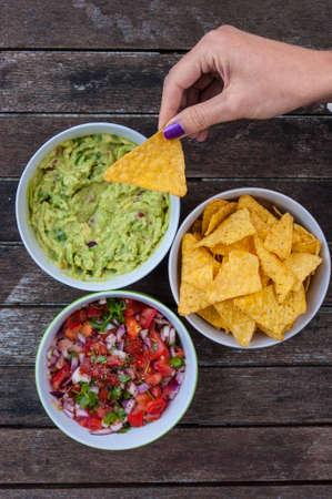 tasty nachos and dips Banco de Imagens