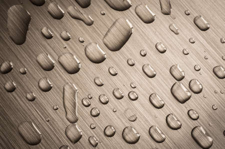 brushed aluminium: Rain drops on brushed metal surface Stock Photo