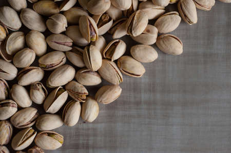 grey background texture: Pistachio nuts on grey background texture Stock Photo