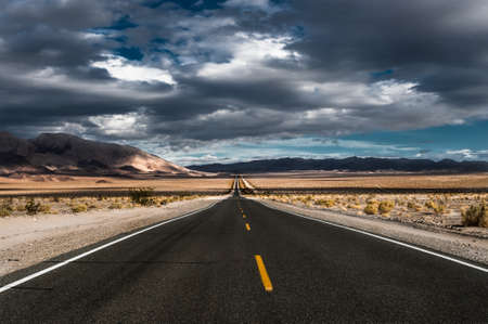 Stormy desert highway in death valley photo