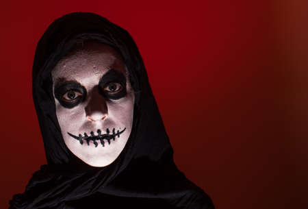 Scary skull woman red background photo