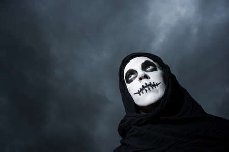 scary skull woman with cloudy skies background photo