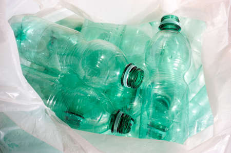 Empty green plastic bottles sorted for recycling photo