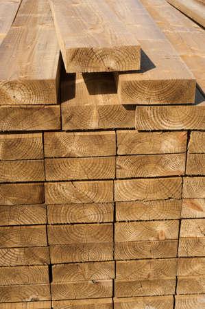 2x4: Stacks of wood planks in lumber yard