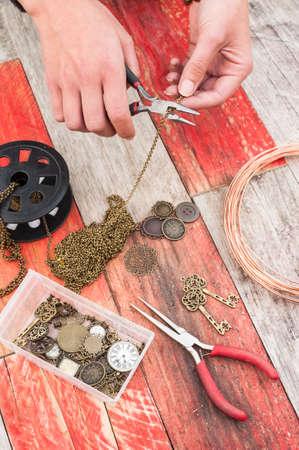 craft jewellery making on wood background