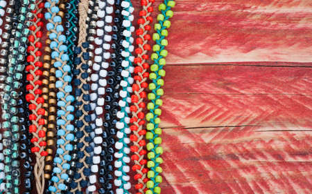 seed beads: colourful bead bracelets on grungy wood background