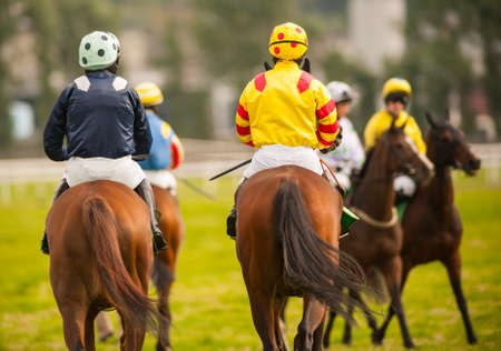 thoroughbred horse: horse riders on the race track  Stock Photo