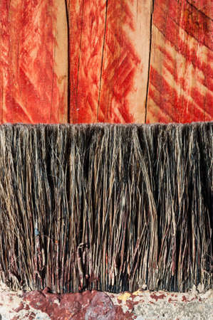 bristles: closeup paint brush bristles on grunge wood texture