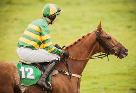 Closeup of a jockey and race horse Stock Photo