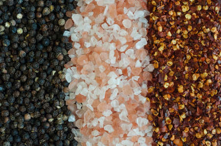 salt and pepper: salt, pepper and chili pepper background texture