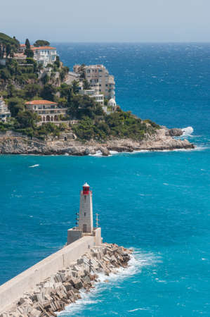 boron: Lighthouse at the entrance to the old port of Nice in France