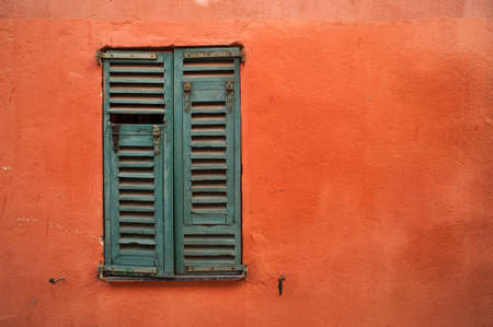 orange texture: green window shutters on orange texture wall