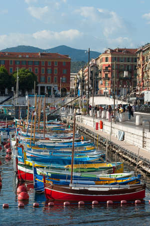 nice france: colourful boats docked in the port of Nice in the south of France