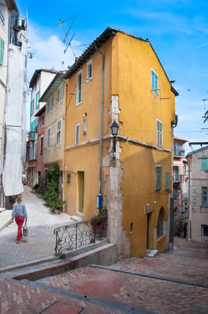 french riviera: Walking through old cobblestone streets of villefranche-sur-mer on the French riviera. Stock Photo
