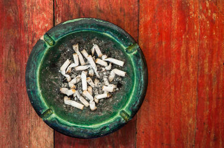 fag: grungy background cigarette butts ashtray Stock Photo