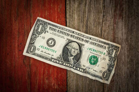 old One dollar bill on grunge wood background Stock Photo