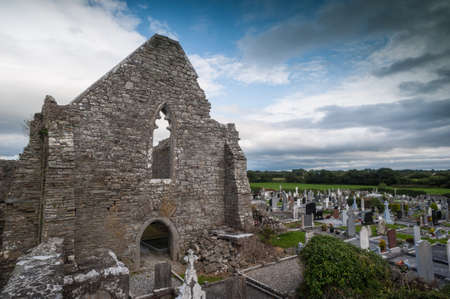 church ruins: cemetery on the grounds of old church ruins in rural Ireland Stock Photo