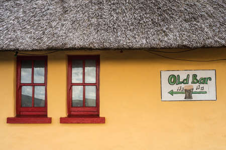 thatched: old traditional thatched irish pub background