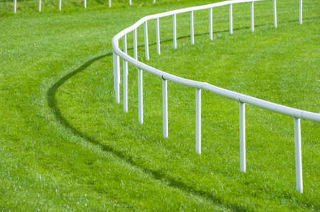 race: close up railing bend of a horse race track