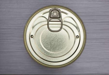 brushed metal background: shiny aluminium food can  on brushed metal background