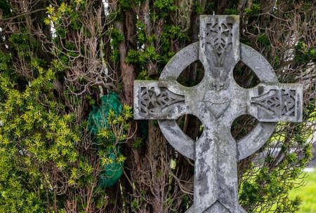 ancient ireland celtic cross: old celtic cross gravestone background Stock Photo