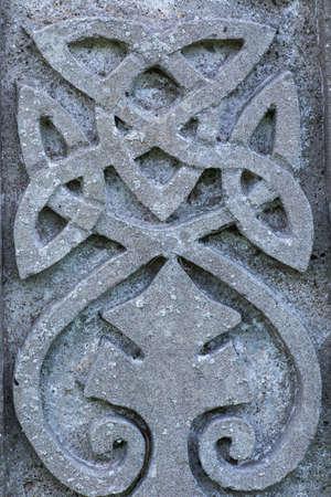 irish history: Old stone carved Celtic design symbol