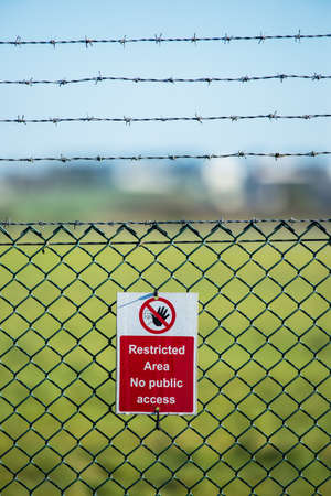 dissuade: Restricted area airport sign outside runway