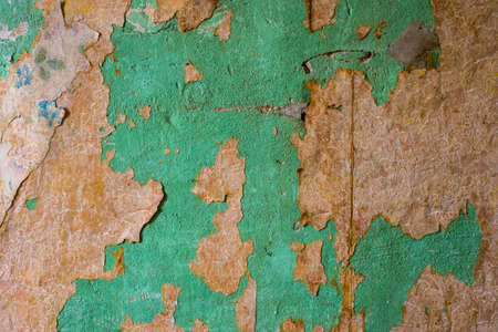 crackles: Old wall peeling wallpaper grunge wall background Stock Photo